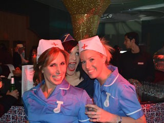 Give as you Live team nursing a drink