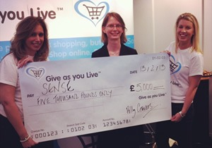 2012 winner Sense receiving £5,000 from Give as you Live