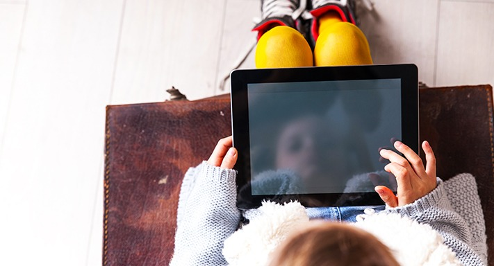 child-on-tablet
