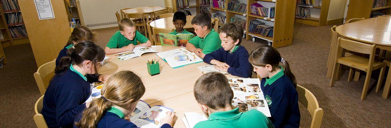 School children sat around a table
